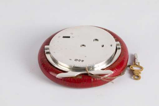 Red Leather and Silver Clock